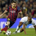Barcelona's Messi runs with the ball after avoiding a tackle from Manchester City's Kompany during their Champions League last 16 second leg soccer match
